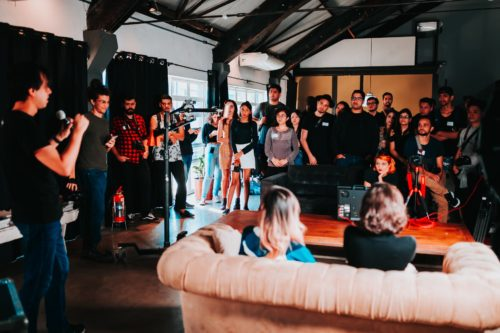 group of people standing inside room